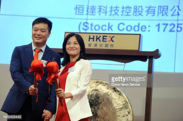 Ma Fujun Chief Executive Officer and Chairman of Eternity Technology Holdings Limited and his wife Cheng Lihong attend the company's listing ceremony...