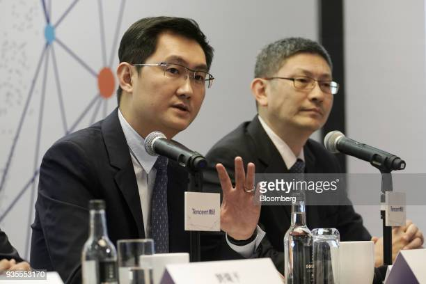 Ma Huateng chairman and chief executive officer of Tencent Holdings Ltd left speaks as John Lo chief financial officer looks on during a news...