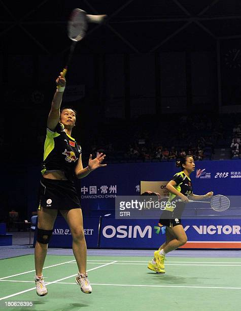 Ma Jin and Tang Jinhua of China return a shot to compatriots Wang Xiaoli and Yu Yang during the women's doubles final match of the 2013 China Masters...