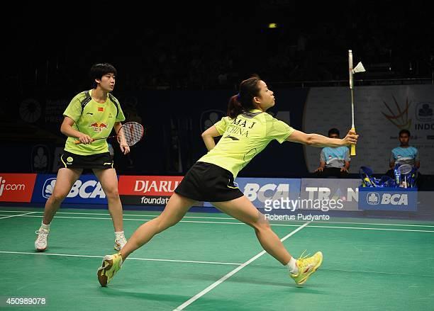 Ma Jin and Tang Yuanting of China return a shot against Jang Ye Na and So Young Kim of Korea during the semifinal BCA Indonesia Open 2014 MetLife BWF...