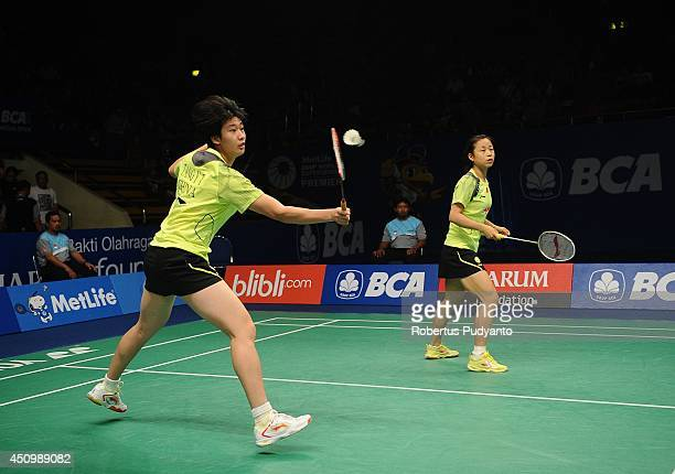 Ma Jin and Tang Yuanting of China return a shot against Jang Ye Na and So Young Kim of Korea during the semifinal BCA Indonesia Open 2014 MetLife BWF...