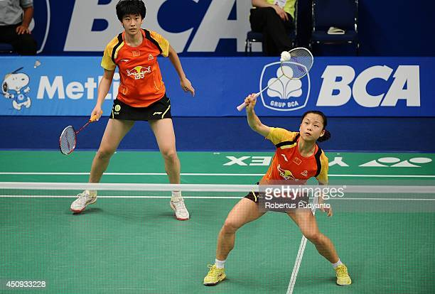 Ma Jin and Tang Yuanting of China return a shot against Shinta Mulia Sari and Lei Yao of Singapore during the BCA Indonesia Open 2014 MetLife BWF...