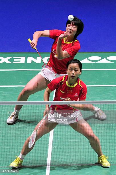Ma Jin and Tang Yuanting of China return against Wang Xiaoli and Yu Yang of China in their All England Open Badminton Championships women's doubles...