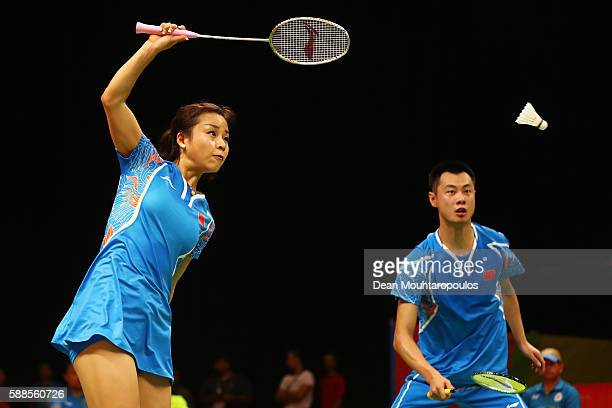 Ma Jin and Xu Chen of China compete against Chris and Gabby Adcock of Great Britain or Team GB in the badminton Mixed Doubles on Day 6 of the 2016...