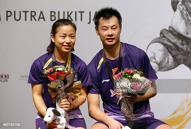Ma Jin and Xu Chen of China poses with their gold medals after they defeated Joachim Fisher Nielsen and Christian Pedersen of Denmark during the...