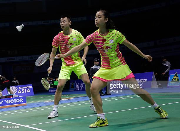 Ma Jin of china hits a return next to her partner Xu Chen during their mixed doubles match against Artur Niyazov and Veronica sorokina of Kazakhstan...