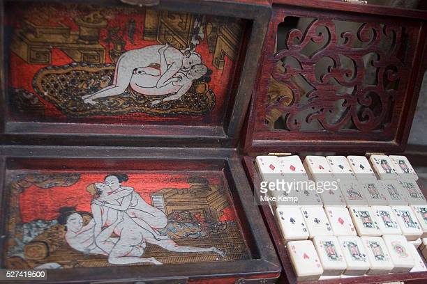 Ma Jong set in sexually illustrated painted box for sale on Dong Tai Road street market This small area dedicated to antiques is lined with shops and...