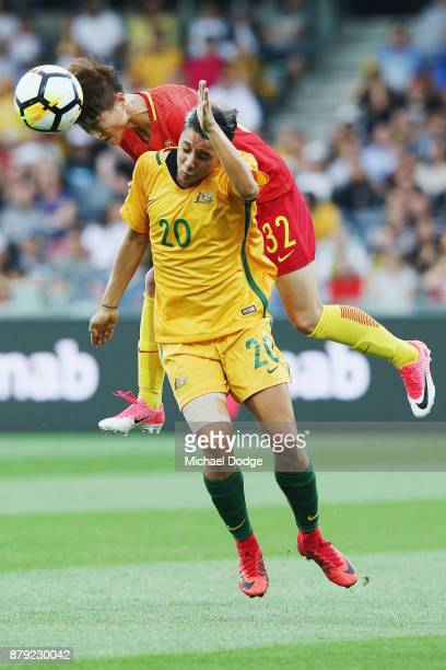 Ma Jun of China PR heads the ball over Sam Kerr of the Matildas during the Women's International match between the Australian Matildas and China PR...