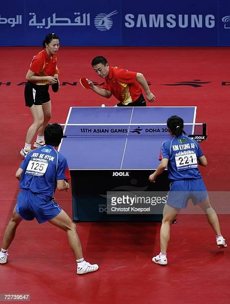 Ma Lin and Wang Nan of China serves against Joo Sea Hyuk and Kim Kyung Ah of South Korea in the mixed double semi final during the 15th Asian Games...