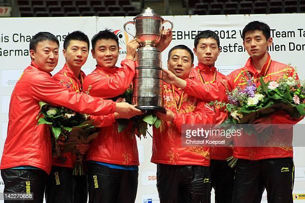 Ma Lin, Ma Long, Wang Hao, coach Liu Guiliang, Xu Xin and Zhang Jike of China pose with the Swaythling cup druing the ceremony after winning 3-0 the...
