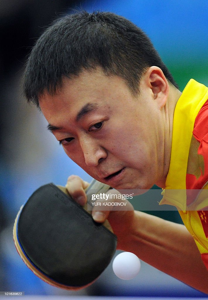 Ma Lin of China returns a service to Kaii Yoshida of Japan during the men's semi final at the 2010 World Team Table Tennis Championships in Moscow on May 29, 2010.