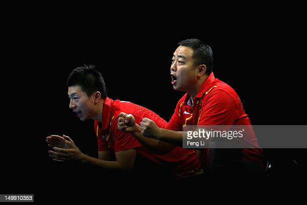 Ma Long and coach Liu Guoliang of China celebrate during Men's Team Table Tennis semifinal match against team of Germany on Day 10 of the London 2012...
