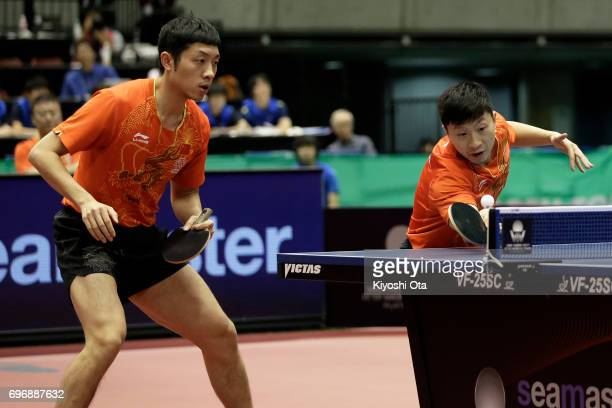 Ma Long and Xu Xin of China compete in the Men's Doubles final match against Koki Niwa and Maharu Yoshimura of Japan during day four of the 2017 ITTF...