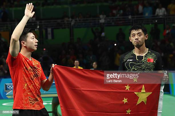 Ma Long and Zhang Jike of China are seen after the Mens Table Tennis Gold Medal match between Ma Long of China and Zhang Jike of China at Rio Centro...