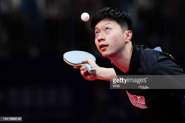 Ma Long of Beijing competes in the Men's Table Tennis Group Final Match against Guangdong during China's 14th National Games at Yan'an University...