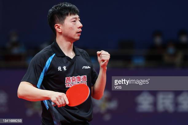 Ma Long of Beijing reacts in the Men's Table Tennis Group Final Match against Guangdong during China's 14th National Games at Yan'an University...