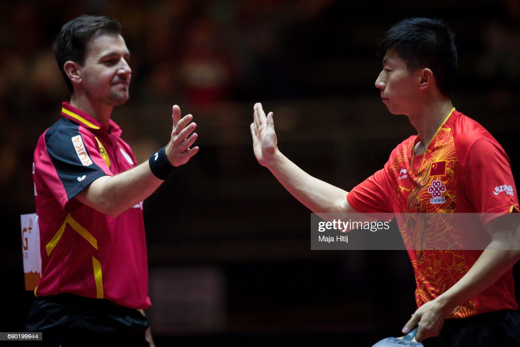 Ma Long of China and Timo Boll of Germany (L) celebrate after Men Double 1. Round at Table Tennis World Championship at Messe Duesseldorf on May 30, 2017 in Dusseldorf, Germany.