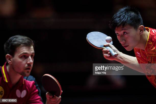 Ma Long of China and Timo Boll of Germany compete during Men Double 1 Round at Table Tennis World Championship at Messe Duesseldorf on May 30 2017 in...