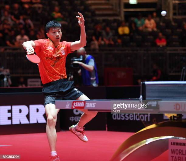 Ma Long of China and Timo Boll of Germany compete during Men's Doubles first round match on day 2 of 2017 World Table Tennis Championships at Messe...
