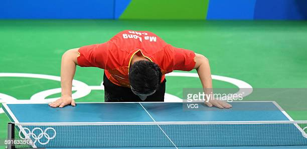 Ma Long of China celebrates after beating Japanese team during the Men's Table Tennis gold medal match on Day 12 of the Rio 2016 Olympic Games at...
