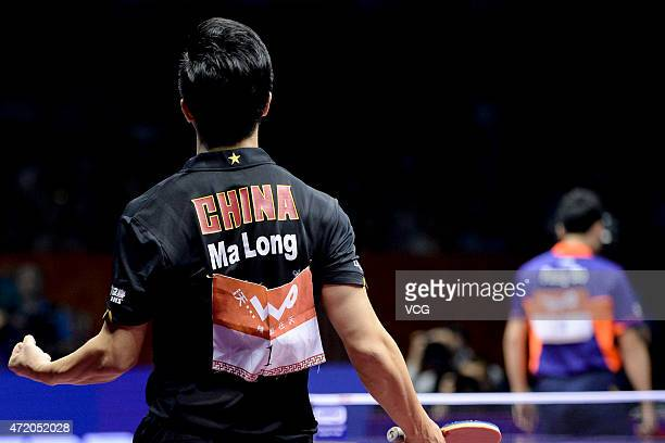 Ma Long of China celebrates after winning men's singles final match against Fang Bo of China on day eight of the 2015 World Table Tennis...