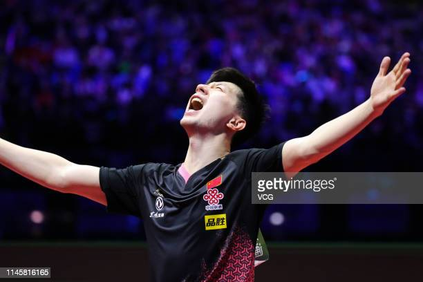 Ma Long of China celebrates after winning the Men's Singles final match against Mattias Falck of Sweden on day eight of the ITTF World Table Tennis...