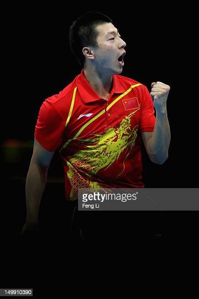 Ma Long of China celebrates during Men's Team Table Tennis semifinal match against team of Germany on Day 10 of the London 2012 Olympic Games at...