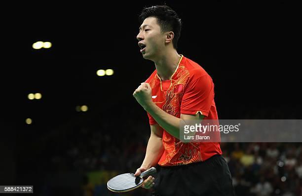 Ma Long of China celebrates during the Mens Table Tennis Singles Semifinal match between Ma Long of China and Jun Mizutani of Japan at Rio Centro on...
