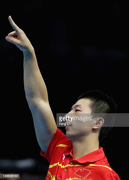 Ma Long of China celebrates winning Men's Team Table Tennis semifinal match against team of Germany on Day 10 of the London 2012 Olympic Games at...