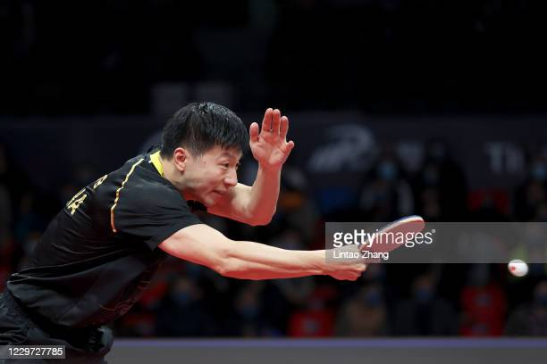 Ma Long of China competes against Fan Zhendong of China during men's single final match on day four of 2020 ITTF Finals at Zhengzhou Olympic Sports...