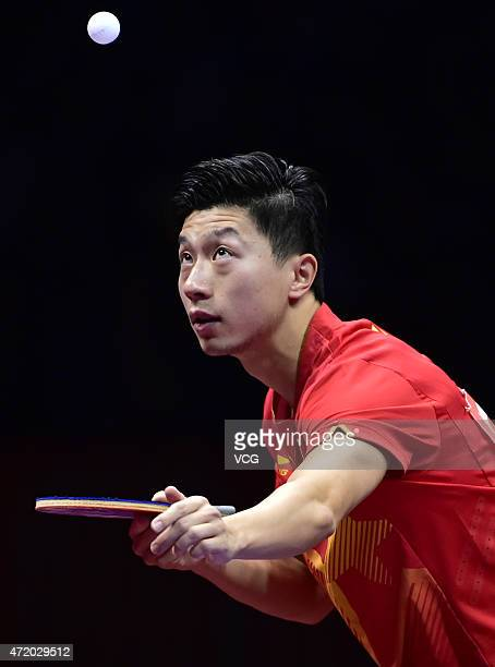 Ma Long of China competes against Fan Zhendong of China during men's singles semifinal match on day eight of the 2015 World Table Tennis...