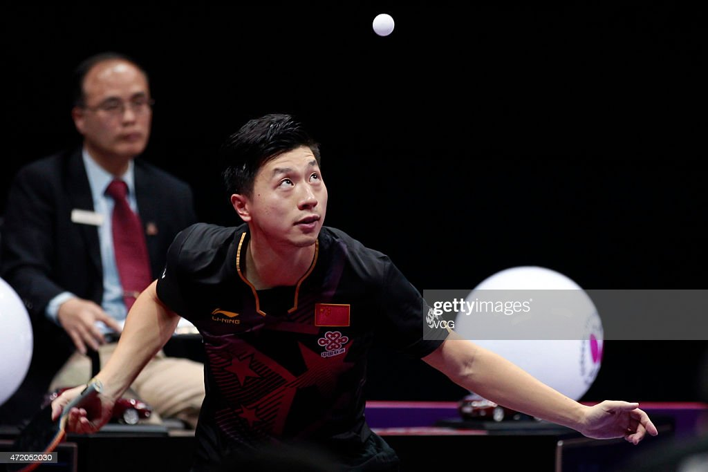 Ma Long of China competes against Fang Bo of China during men's singles final match on day eight of the 2015 World Table Tennis Championships at the Suzhou International Expo Center on May 3, 2015 in Suzhou, China.