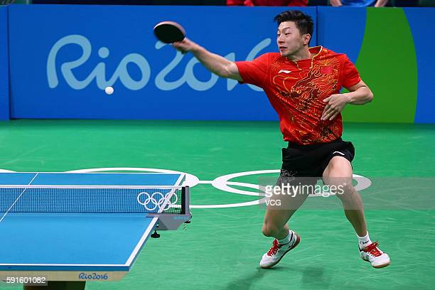 Ma Long of China competes against Koki Niwa of Japan during the Men's Table Tennis gold medal match on Day 12 of the Rio 2016 Olympic Games at...