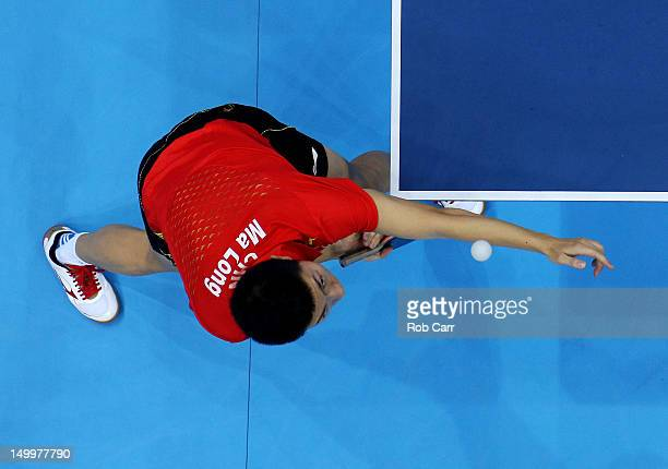 Ma Long of China competes against Seungmin Ryu of Korea during the Men's Team Table Tennis gold medal match on Day 12 of the London 2012 Olympic...