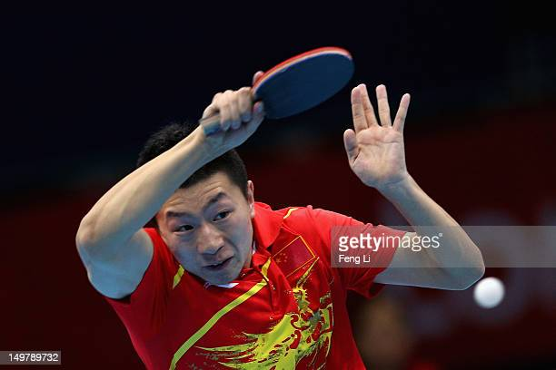 Ma Long of China competes during Men's Team Table Tennis first round match against team of Russia on Day 8 of the London 2012 Olympic Games at ExCeL...