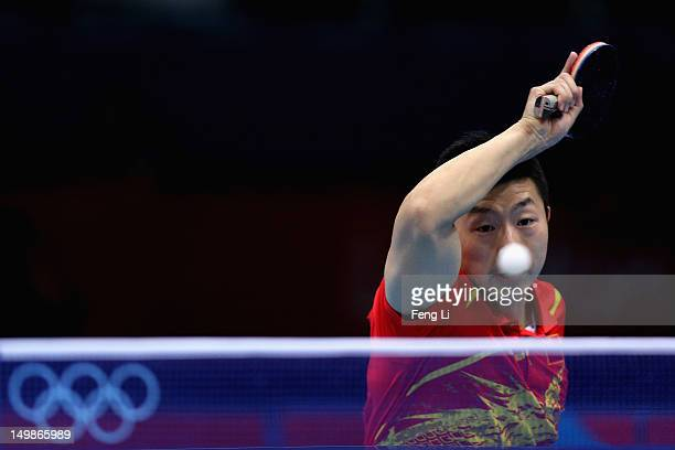 Ma Long of China competes during Men's Team Table Tennis quarterfinal match against team of Singapore on Day 9 of the London 2012 Olympic Games at...