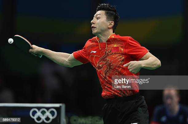 Ma Long of China competes during the Table Tennis Men's Team Quarterfinal Match between China and Great Britain on August 14 2016 in Rio de Janeiro...