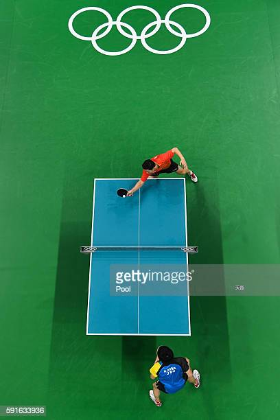 Ma Long of China hits against Koki Niwa of Japan during the men's team table tennis gold medal match on Day 12 of the Rio 2016 Olympic Games at...