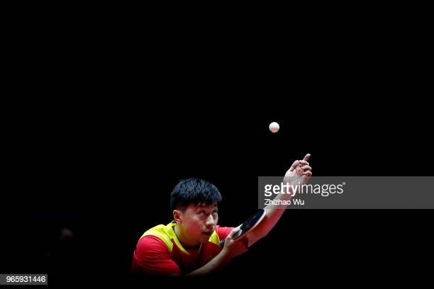 Ma Long of China in action at the men's singles quarter-final compete with Liang Jingkun of China during the 2018 ITTF World Tour China Open on June...