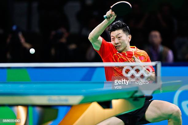 Ma Long of China plays against Zhang Jike of China in Men's Singles Gold Medal Match on day six of the Rio 2016 Olympic Games at Riocentro - Pavilion...