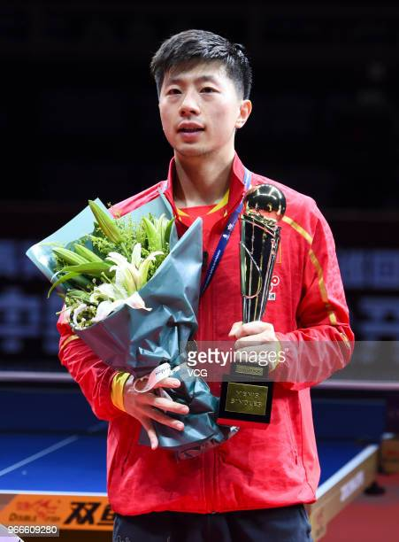 Ma Long of China poses with trophy during awarding ceremony after winning men's singles final match against Fan Zhendong of China on day four of the...