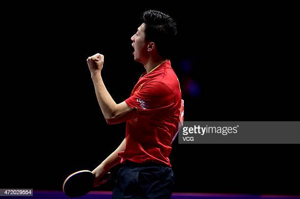 Ma Long of China reacts against Fan Zhendong of China during men's singles semifinal match on day eight of the 2015 World Table Tennis Championships...