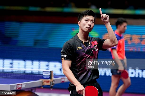 Ma Long of China reacts against Fang Bo of China during men's singles final match on day eight of the 2015 World Table Tennis Championships at the...