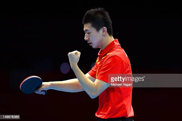 Ma Long of China reacts while competing against Seungmin Ryu of Korea during the Men's Team Table Tennis gold medal match on Day 12 of the London...
