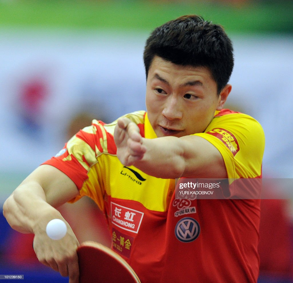 Ma Long of China returnes a service to Vladimir Samsonov of Belarus during the men's quarter final at the 2010 World Team Table Tennis Championships in Moscow on May 28, 2010.