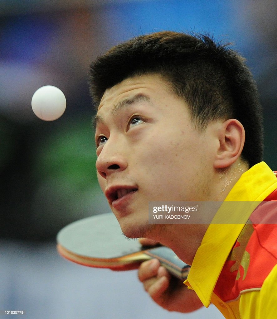 Ma Long of China returns a service to Jun Mizutani of Japan during the men's semi final at the 2010 World Team Table Tennis Championships in Moscow on May 29, 2010.