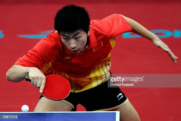 Ma Long of China returns a shot to Kaii Yoshida of Japan during the Men's Table Tennis Team Stage One at the 15th Asian Games Doha 2006 at AlArabi...