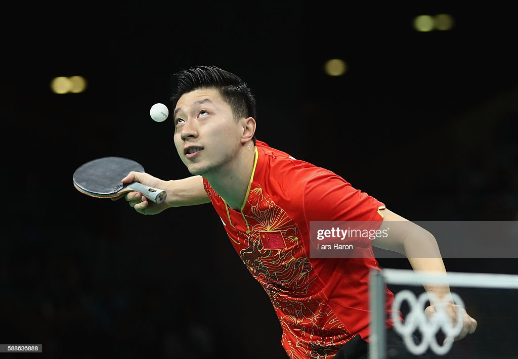 Ma Long of China serves during the Mens Table Tennis Gold Medal match between Ma Long of China and Zhang Jike of China at Rio Centro on August 11, 2016 in Rio de Janeiro, Brazil.