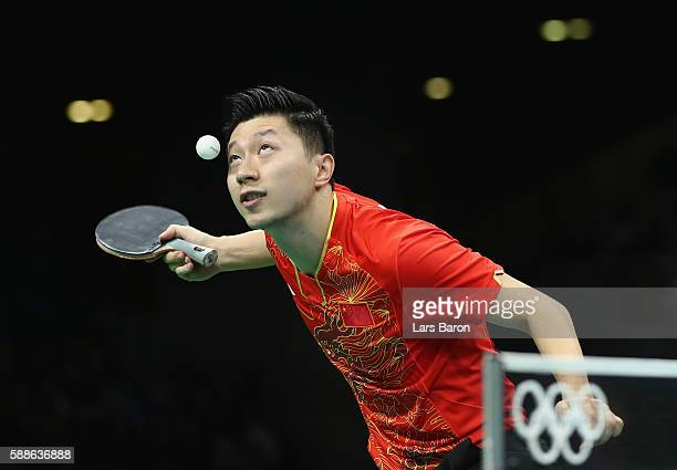 Ma Long of China serves during the Mens Table Tennis Gold Medal match between Ma Long of China and Zhang Jike of China at Rio Centro on August 11...