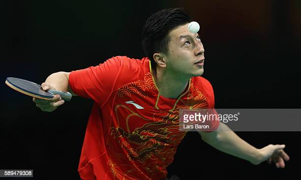 Ma Long of China serves during the Table Tennis Men's Team Quarterfinal Match between China and Great Britain on August 14 2016 in Rio de Janeiro...
